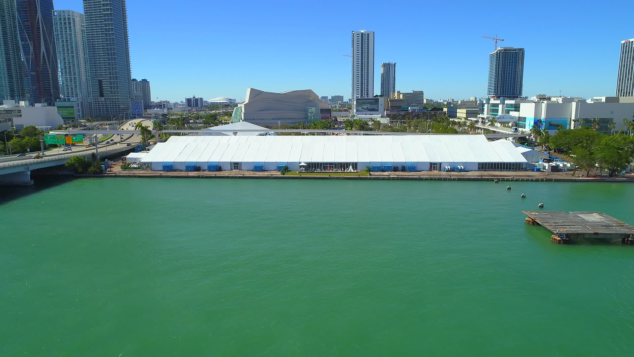 Aerial video Downtown Miami Art Basel event venue tents metrorail tram in motion
