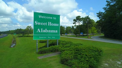Welcome to sweet home alabama sign highway I10 aerial video