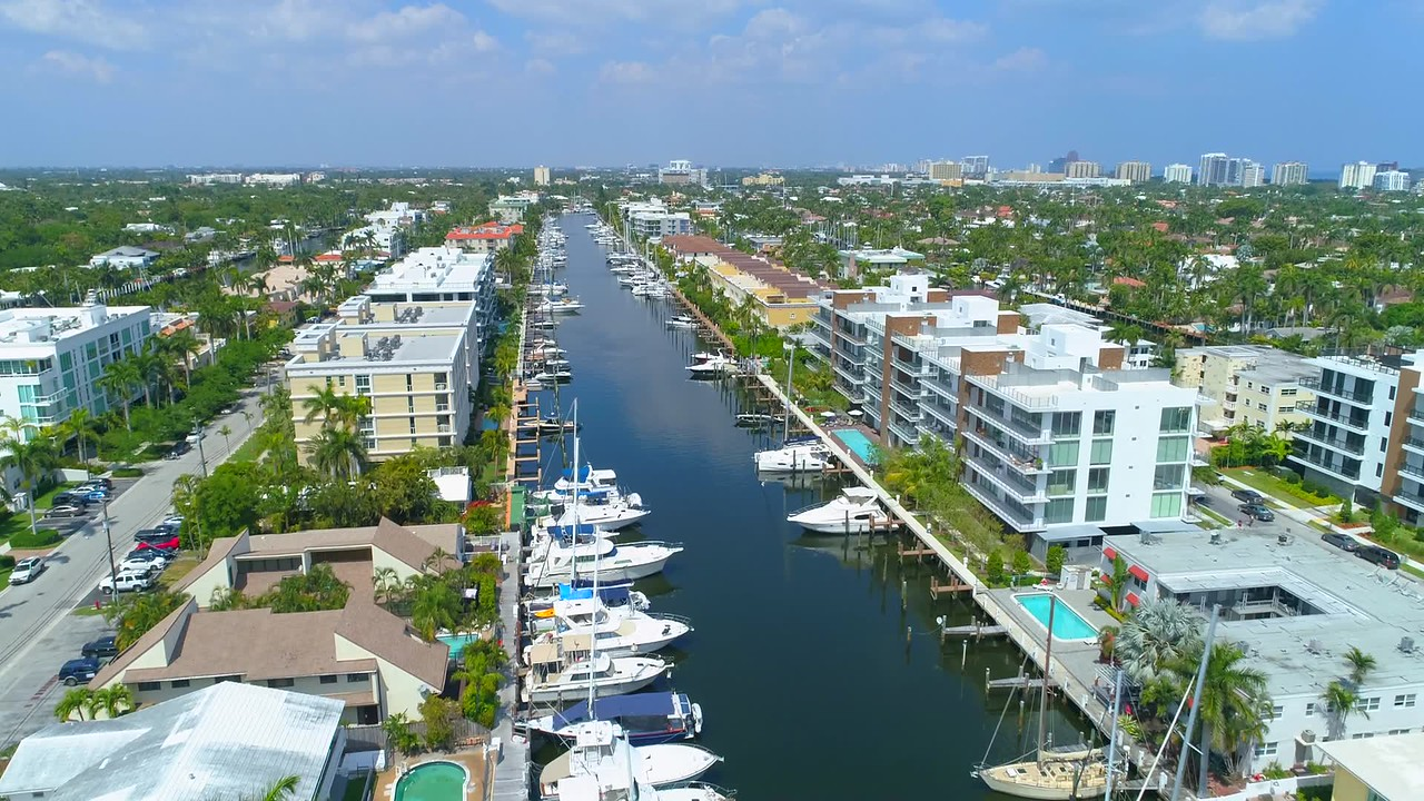 Residential Florida condos with dock aerial drone video footage