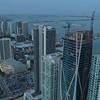 Aerial orbit around building reveal Downtown Miami twilight