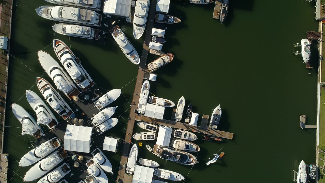 Direct overhead shot Miami Beach boat show yachts 4k 60p