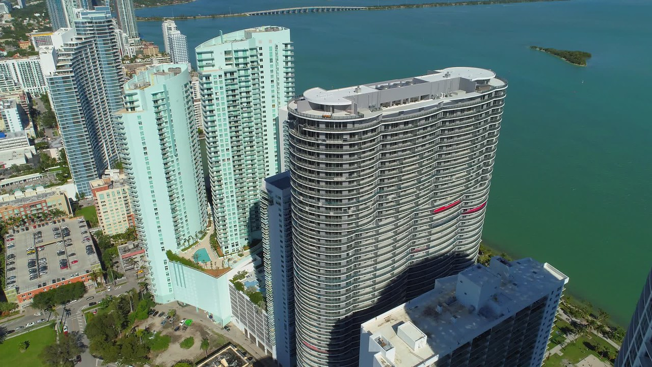 Aerial shot drone flying over towers Miami bayfront edgewater 4k 24p