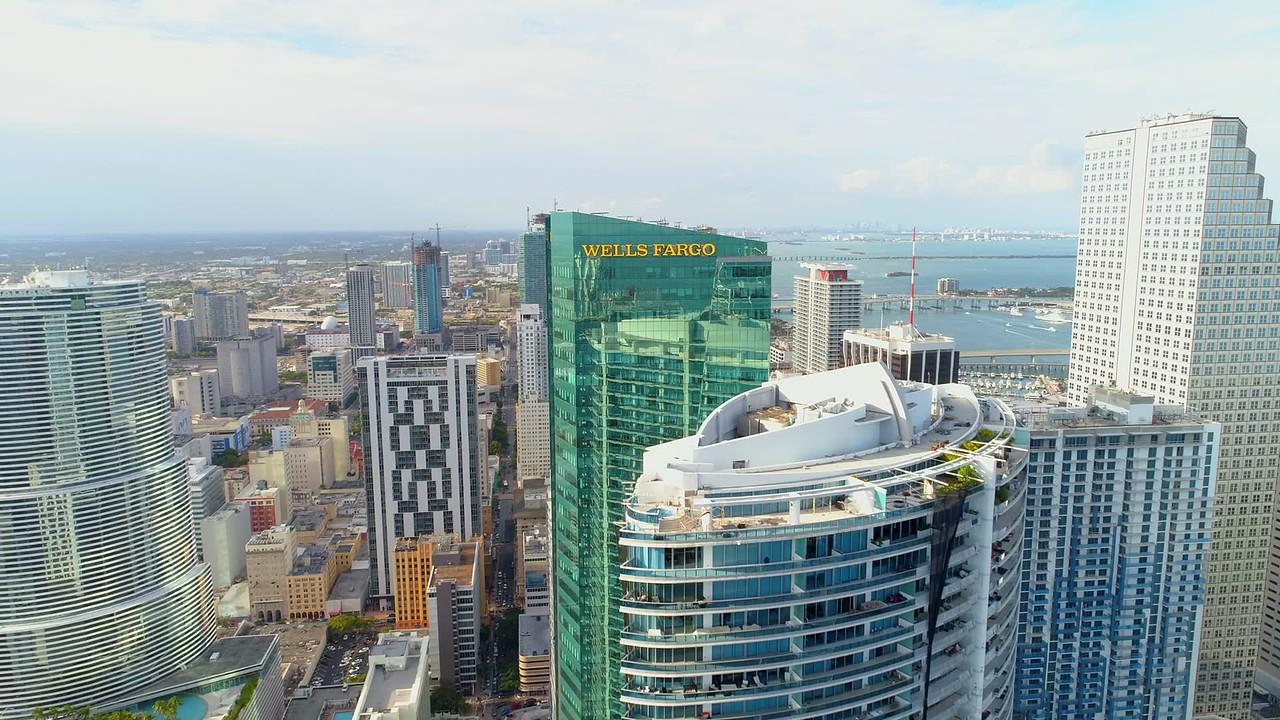 Aerial flyover Wells Fargo Bank building Downtown Miami