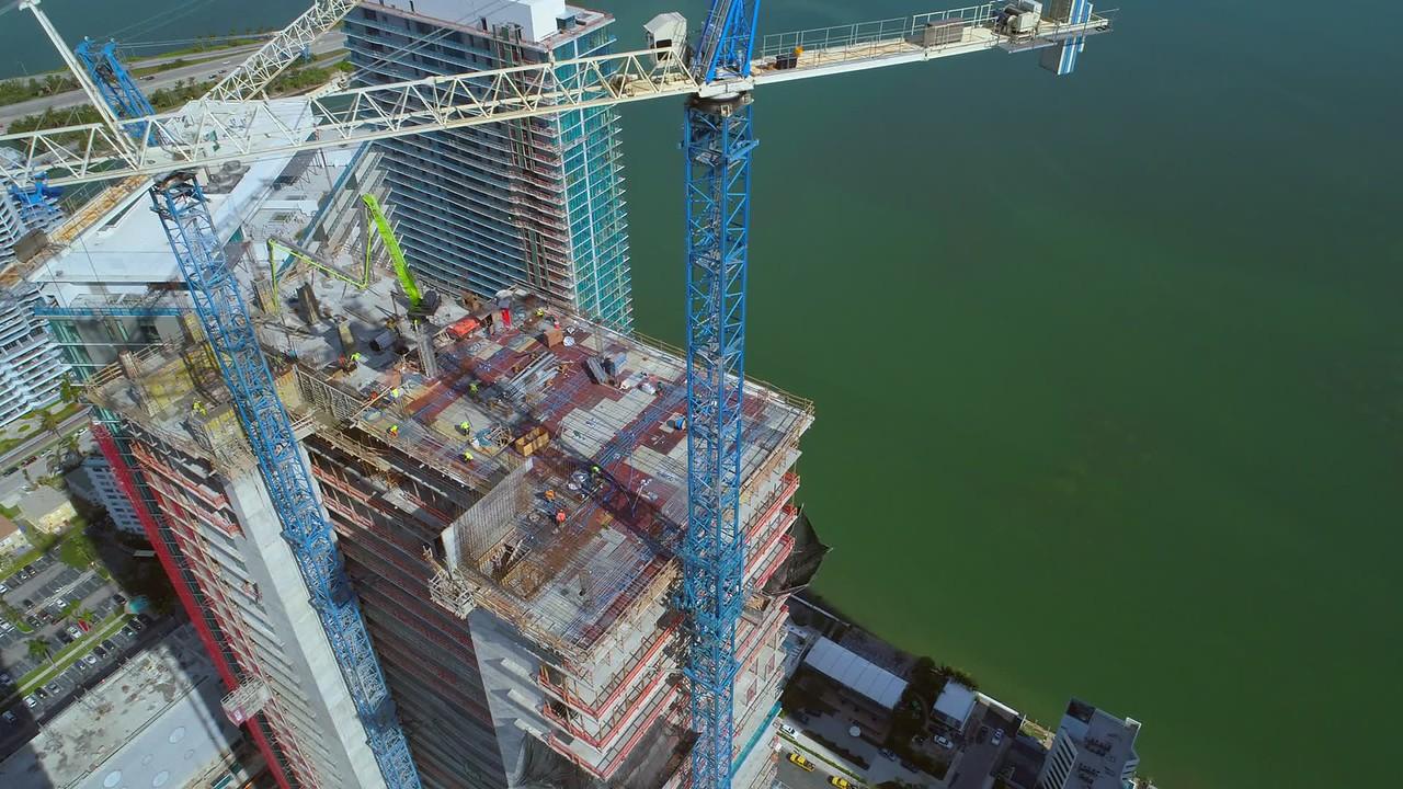 Cranes and condominiums aerial video