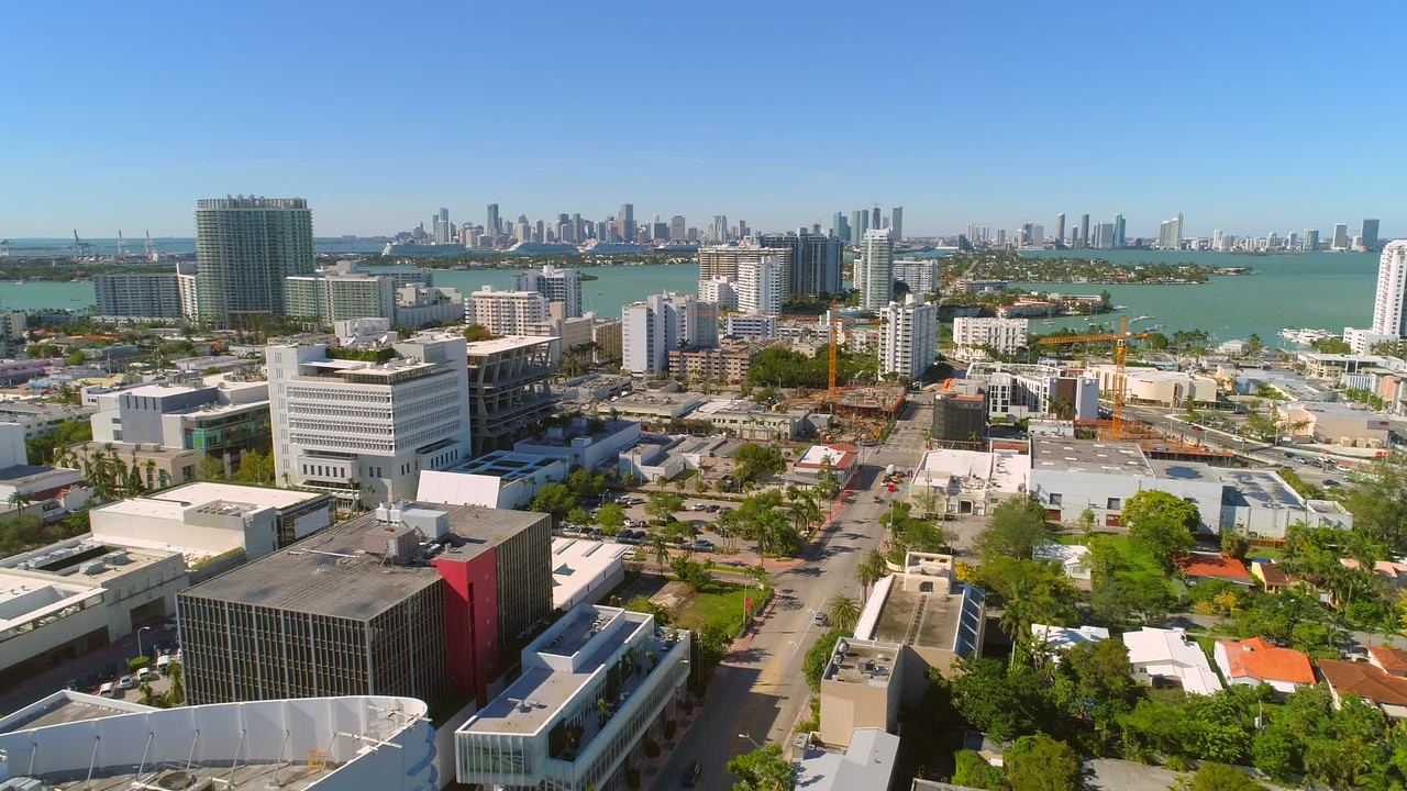 Aerial video Miami Beach with Downtown across the bay 4k 24p