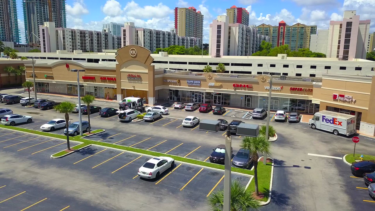 Hurricane Irma shopping center boarding up with shutters aerial shot