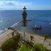 Drone orbit shot Hillsboro Inlet Lighthouse Pompano Beach FL 4k 60p