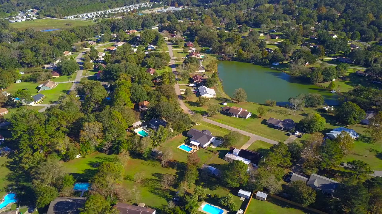 Aerial tour Tallahassee developed neighborhoods 4k 24p