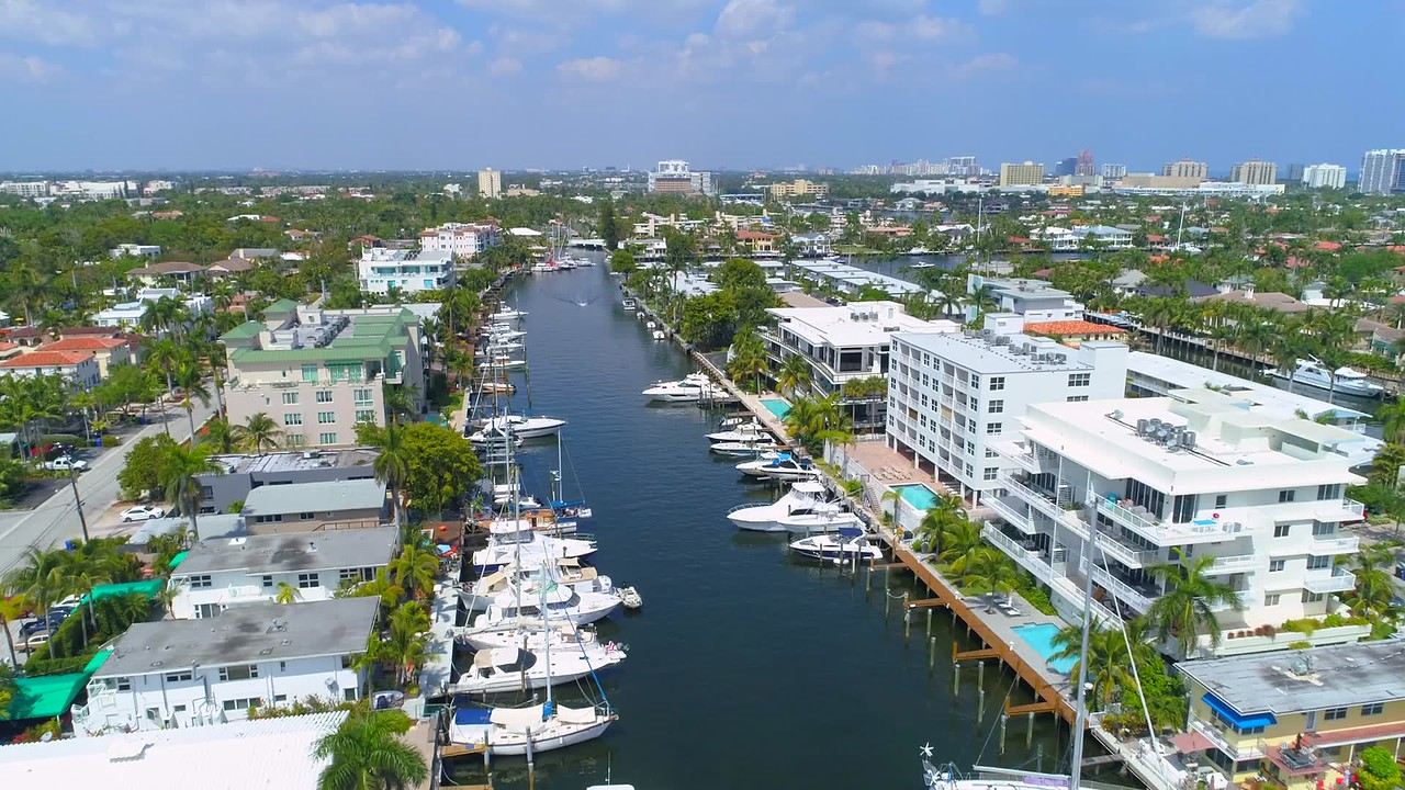 Drone shot Fort Lauderdale Florida residential neighborhoods on canal 4k 60p