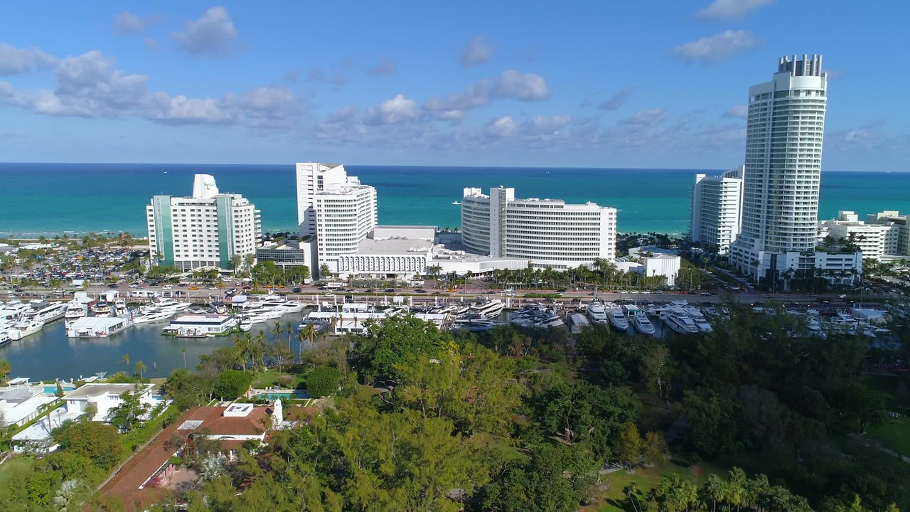 Aerial shot revealing Miami Beach iconic hotels 4k