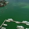 Aerial drone tilt up reveal Venetian Islands Miami Beach Biscayne Bay
