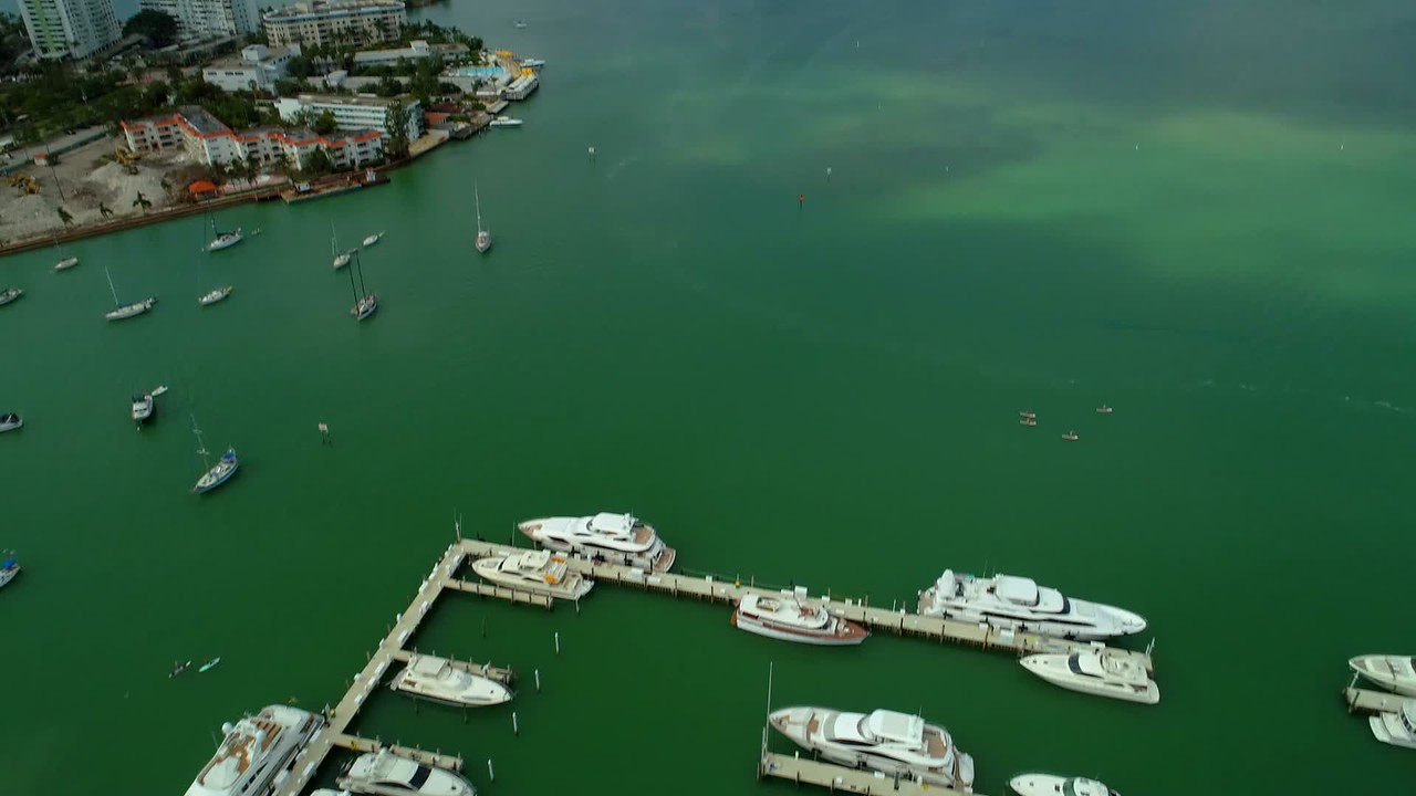 Aerial drone tilt up reveal Venetian Islands Miami Beach Biscayne Bay