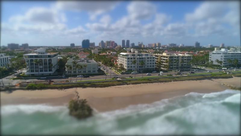 Aerial miniature tilt shift drone video Palm Beach waves 4k 60p