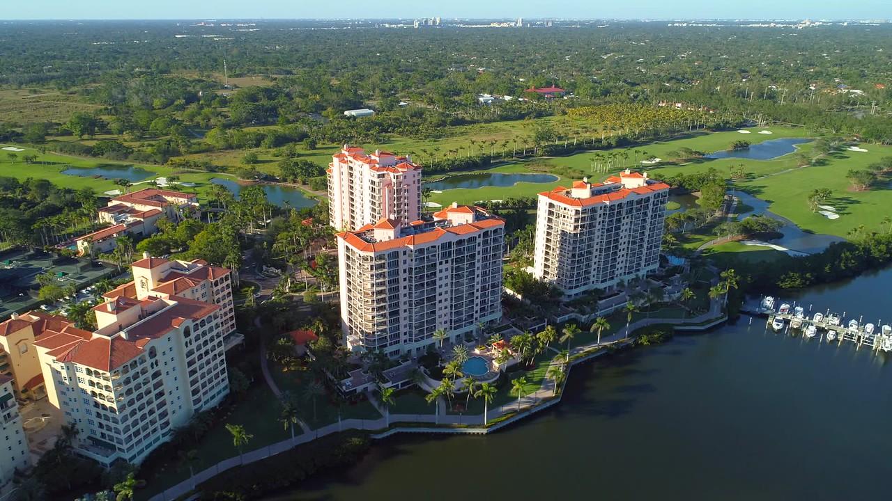 Cinematic aerial orbit condominium apartments on a lake