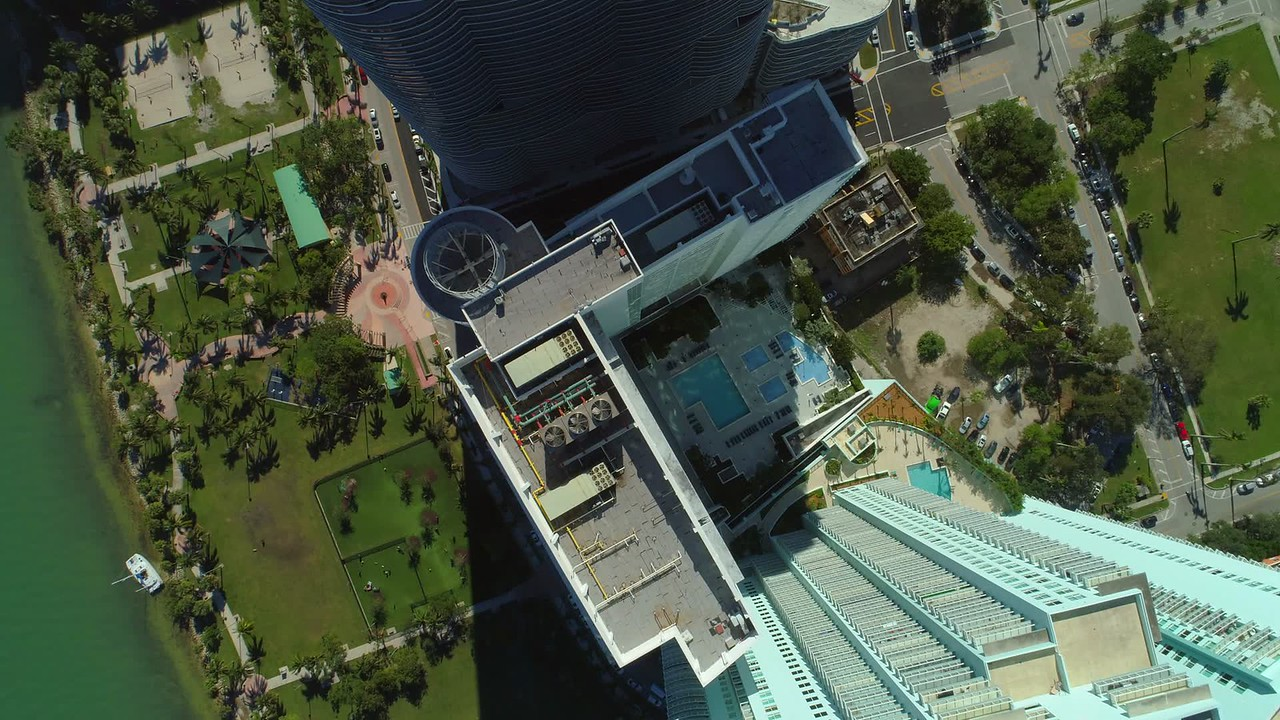 Fast aerial motion flying over highrise buildings drone 4k