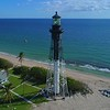 Orbiting aerial video Hillsboro Inlet Lighthouse Pompano Beach FL 4k 60p