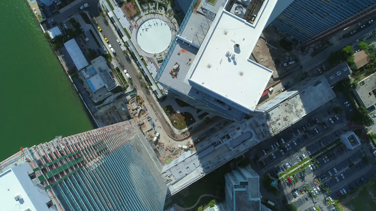Stock video direct overhead flyover highrise buildings under construction