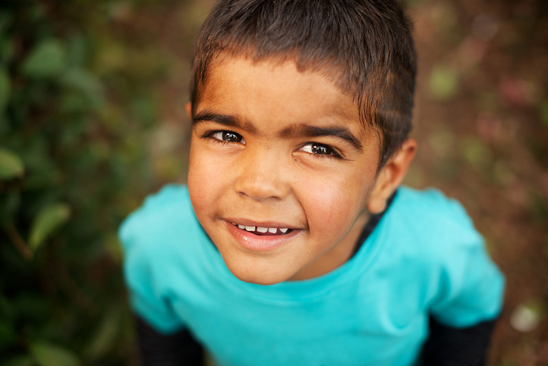 Little Aboriginal Boy Looking up at Camera