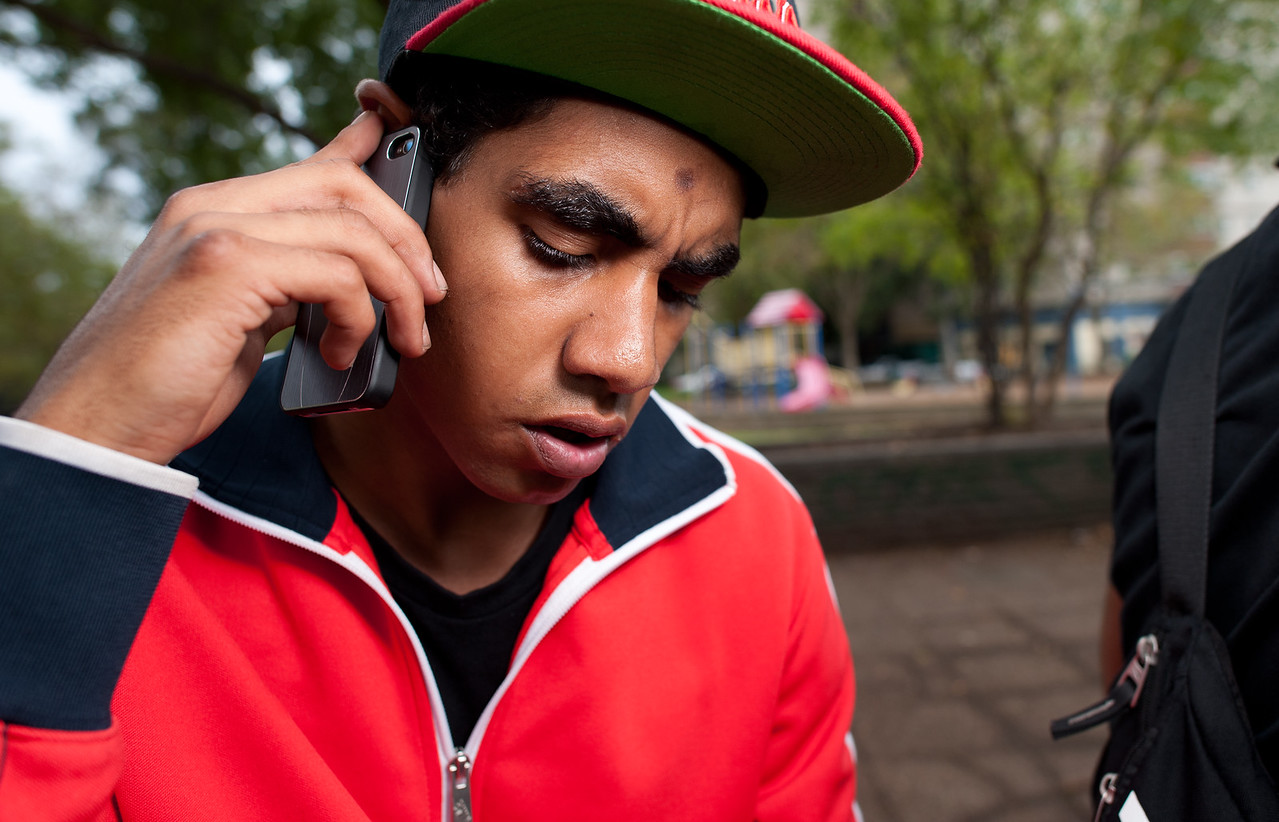 Young Aboriginal Man on a Smartphone