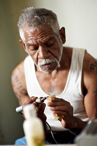 Aboriginal Artist concentrating