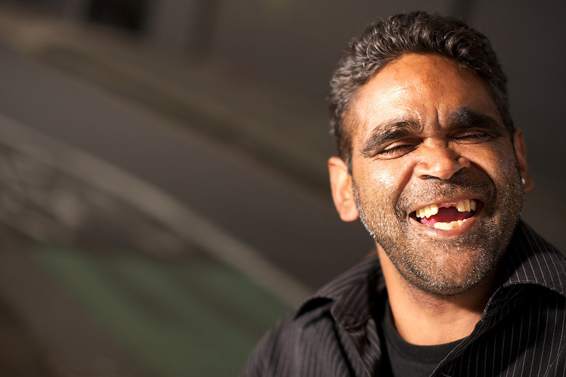 Indigenous Australian Man laughing with his eyes closed.