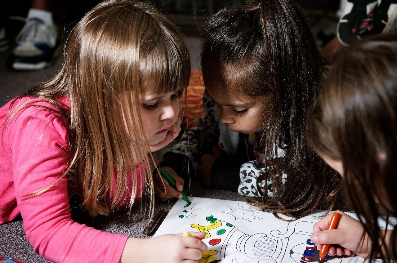 Three Girls Drawing