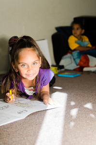 Little Girl Colouring - In on Floor