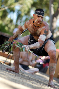 An Indigenous Australian Dancer during an outdoor performance, with a blurred background and plenty of copy space