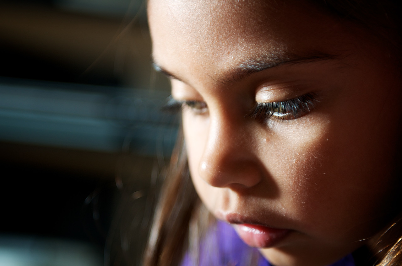 Five-year-old Aboriginal Girl looking down