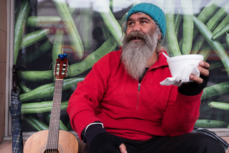Aboriginal Man Taking a Break from Busking