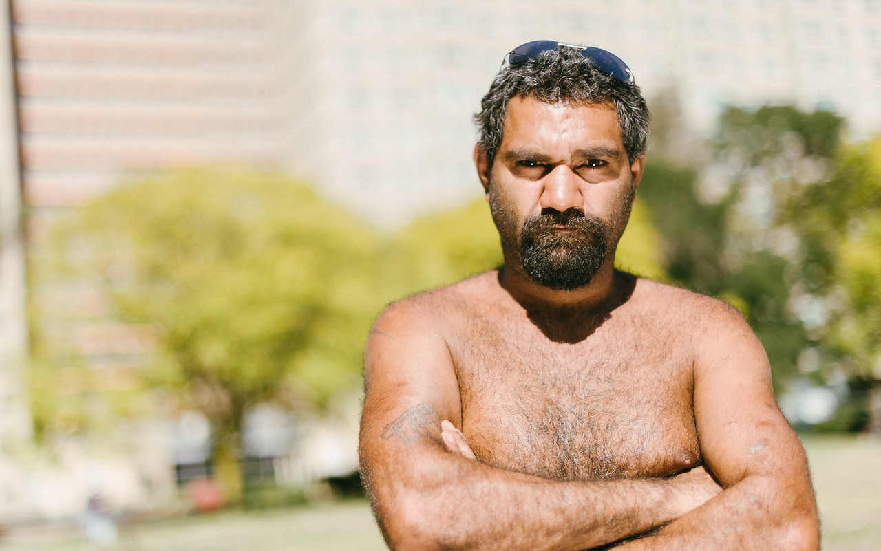 Indigenous Australian Man standing with his Arms Folded