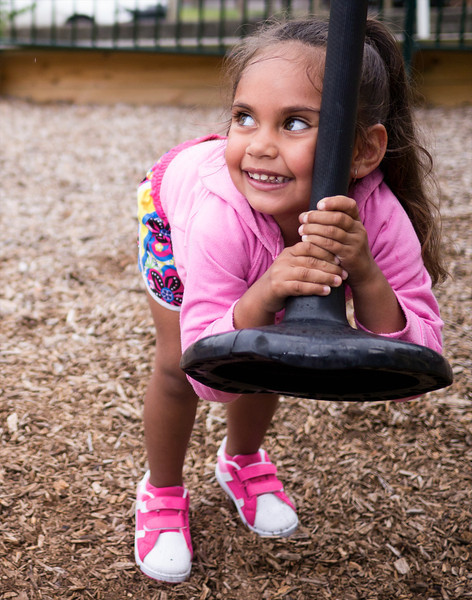 This photo shows a three-year-old Aboriginal girl in an urban setting in the Greater City of Melbourne, Australia.  The photo was made in the playground of a housing estate.