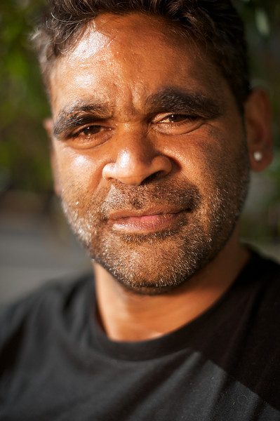 Young Aboriginal man looking at camera, shot with a short depth of field