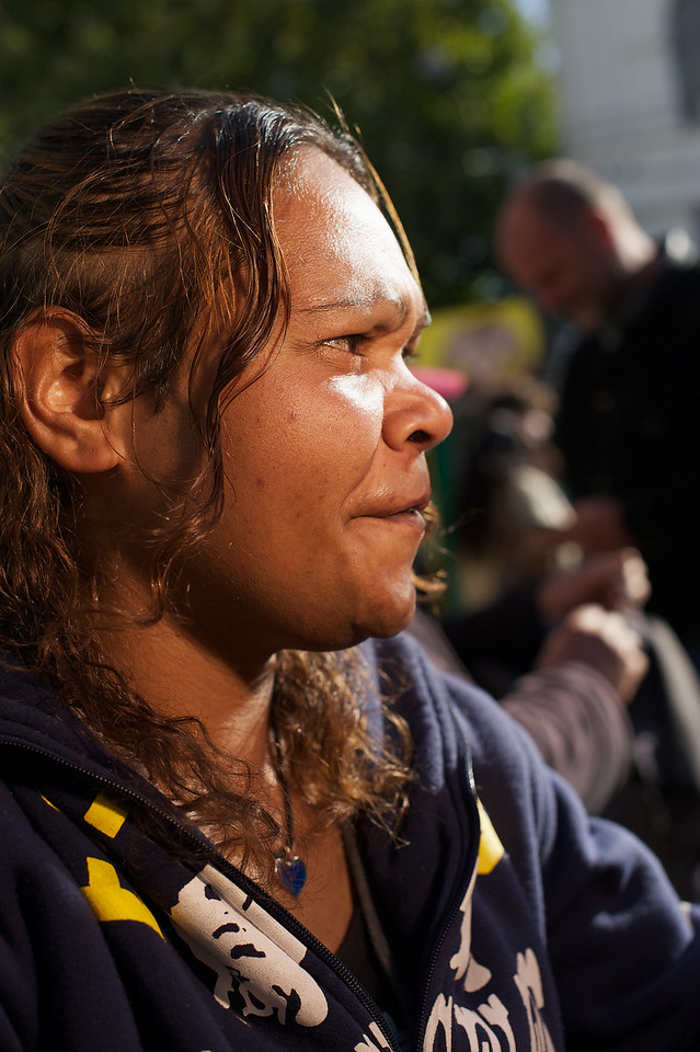 Profile of a young Aboriginal woman outdoors