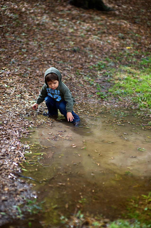 Little Aboriginal Boy in a Puddle