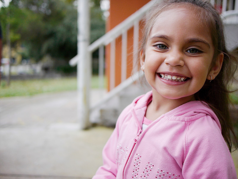 This photo shows a four-year-old Aboriginal girl in an urban setting in the Greater City of Melbourne, Australia.  The photo was made in a housing estate.
