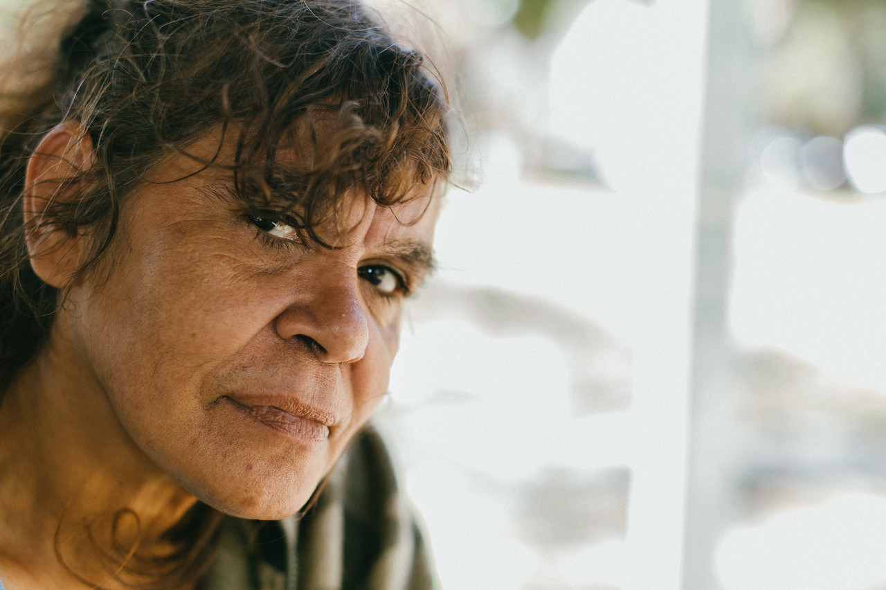 Indigenous Australian Woman on a Bright Background