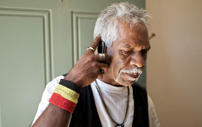 Indigenous Australian Man speaking on a Mobile Phone