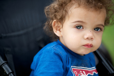 Fifteen-month old Aboriginal child in his pusher, looking at camera.
