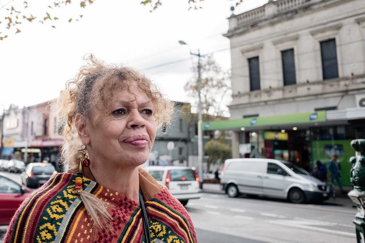 Aboriginal Woman standing in a Shopping Strip