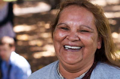 Indigenous Australian woman smiling broadly with beautiful white teeth