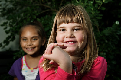A Caucasian girl in the foreground and an Aboriginal girl in the background