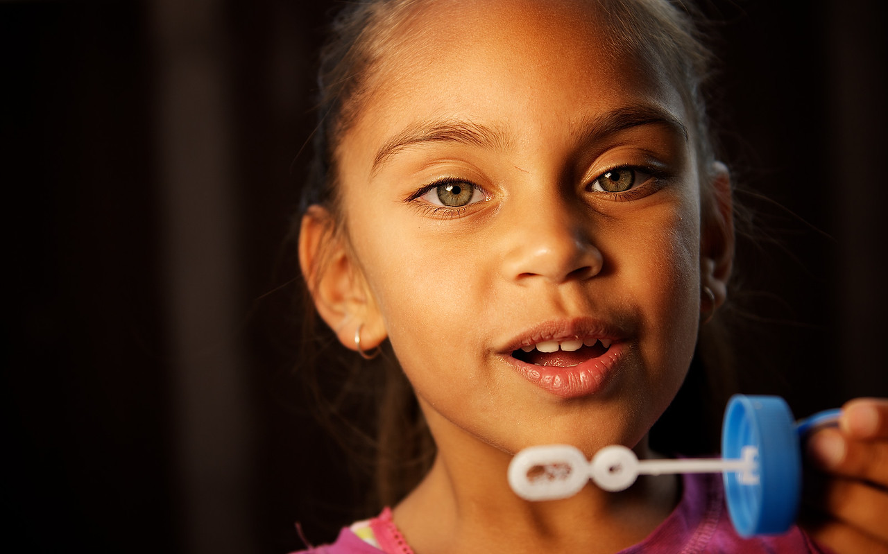 Five-year-old Aboriginal Girl blowing Bubbles