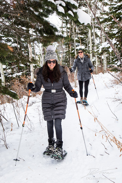 Couple snowshoeing on a trail near Deer Valley, Utah