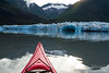 Kayak moving toward the calving face of the Spencer Glacier in Alaska