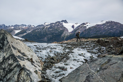 Young woman hiking across the Berendon Glacier in British Columbia