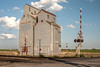 Grain Elevator near Railroad Crossing
