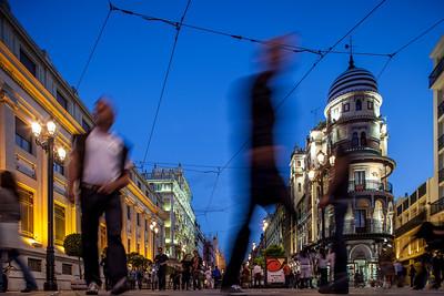 Pedestrians on Constitution Avenue, Seville, Spain