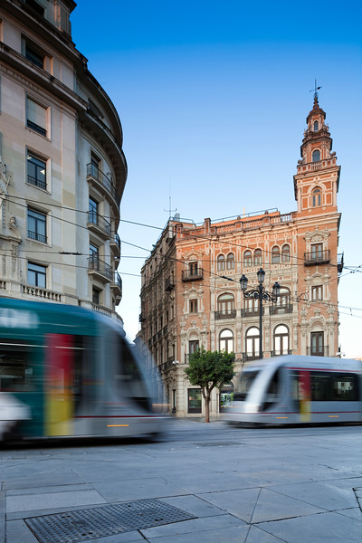 Two streetcars on Constitution Avenue, Seville, Spain