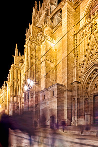 Pedestrians on Constitution Avenue, in front of the Cathedral, Seville, Spain